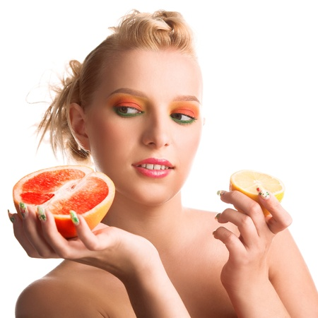 young beauty woman with grapefruit in hand photo