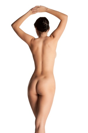woman nude standing: beautiful woman standing of back isolated background Stock Photo