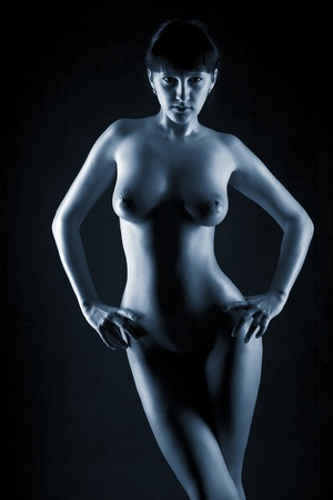 black girl nude: young naked women on black background