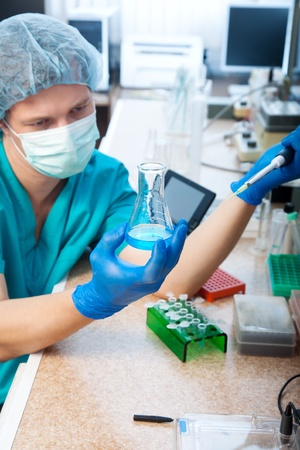 scientist doing DNA test in modern laboratory Stock Photo - 11230927