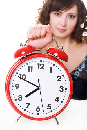 Portrait of young woman with alarm clock photo