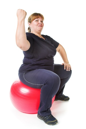 fat woman with big red gimnastic ball photo