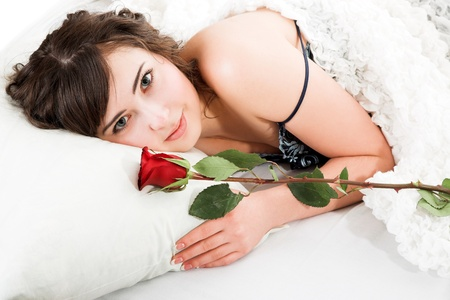 Portrait of young woman holding rose isolated on white  photo
