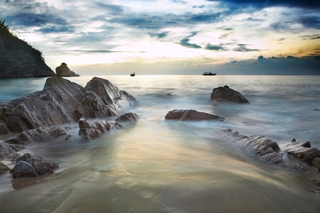 sea landscape with cloudy sky and big stones  스톡 콘텐츠