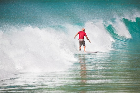Man Surfed on Big Blue Ocean Wave photo