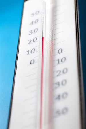 close up photo of thermometer on blue background photo
