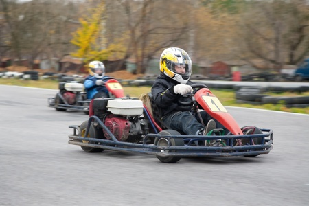 young boy raced on sport kart photo