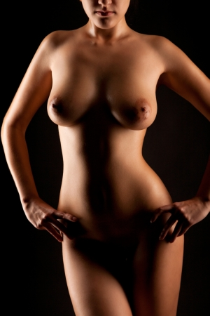 young naked women on black background
