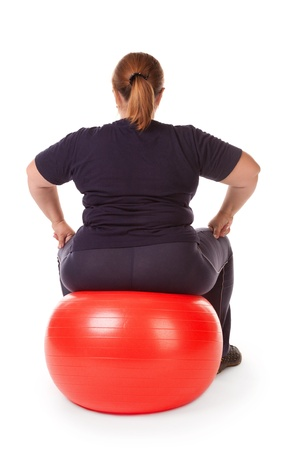 fat woman with big red gimnastic ball