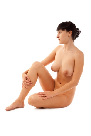nude woman sitting: Naked beautiful woman sitting on the floor