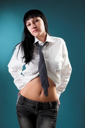 Portrait of beautiful woman on blue cyan background photo