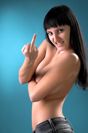 nude girl showing middle finger on blue background photo