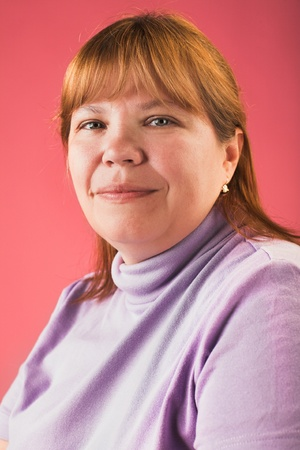 size: portrait of smiling overweight woman on red background