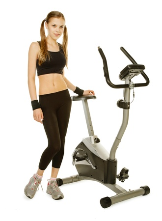 stationary bicycle: beauty girl with gym bicycle machine