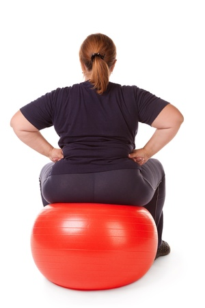fat woman with big red gimnastic ball Stock Photo - 12539219