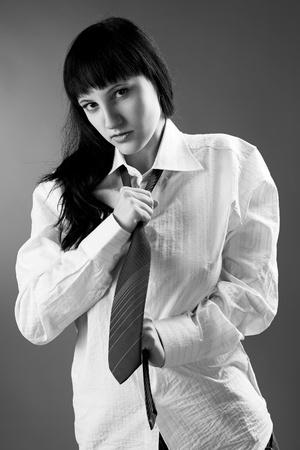 Black-white portrait of beautiful woman on gray background photo