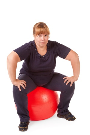 fat woman with big red gimnastic ball Stock Photo - 12775618