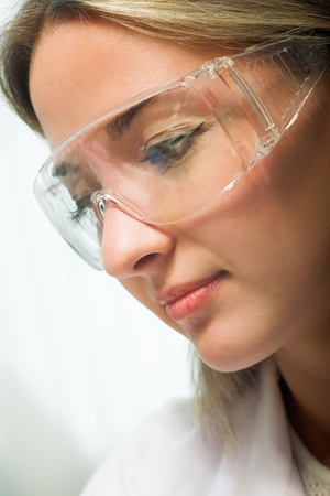 young beauty woman in modern research laboratory photo