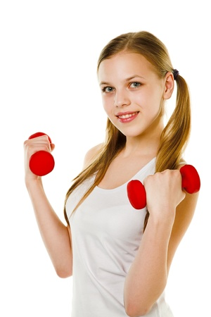 beauty girl with dumbbells isolted on white photo