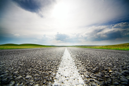 High speed road with cloudy sky background photo