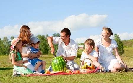 happy family have a picnic outdoor photo