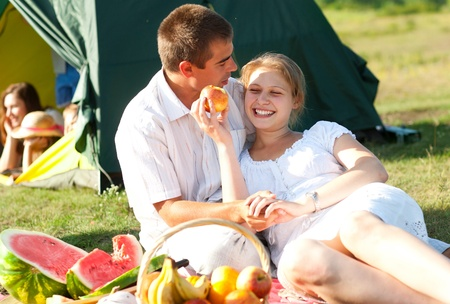 happy couple have picnic outdoor photo