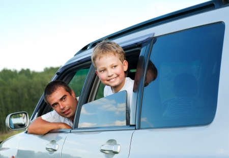 father and son in  the car photo