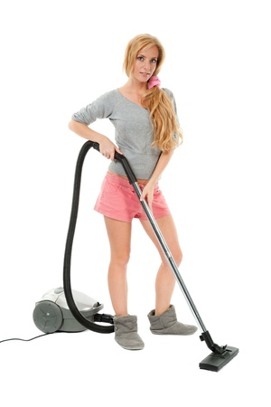beauty housewife with vacuum cleaner isolated on white photo
