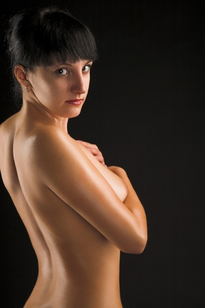 young naked women on black background photo
