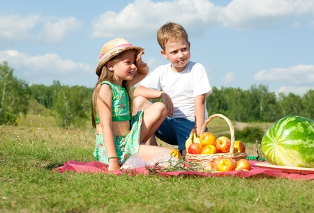 happy family have a picnic outdoor Stock Photo - 13403244