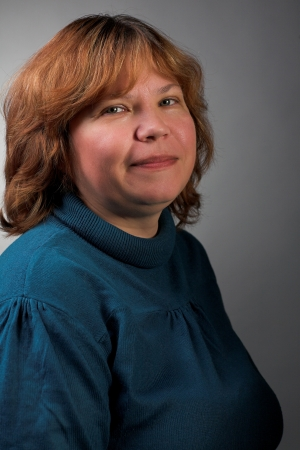 portrait of smiling fat woman on gray background photo