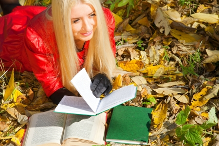 young beauty girl reading book in autumn park Stock Photo - 13791949