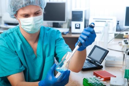 scientist doing DNA test in modern laboratory