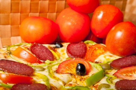 fresh pizza with red tomato photo