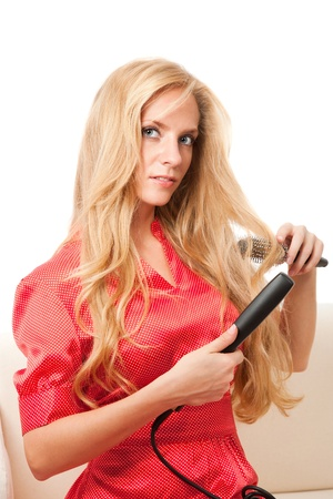 young beauty hairdressing girl with hairbrush photo