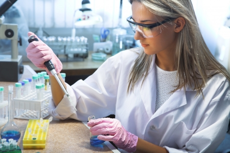 medical laboratory: beautiful woman working in modern laboratory
