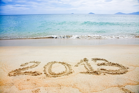 2013 written in sand on beach