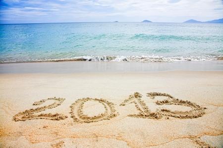 2013 written in sand on beach  Stock Photo - 15718736