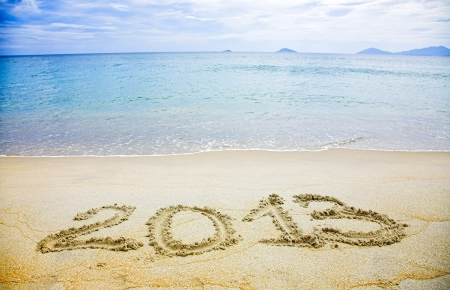 2013 written in sand on beach  photo