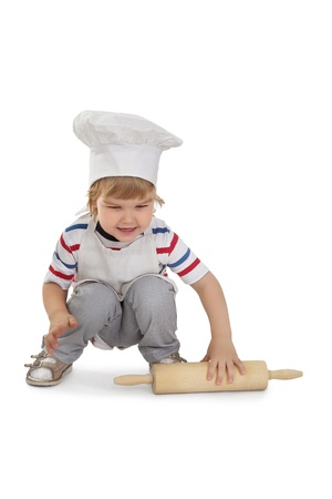 young cook isolated on white background photo