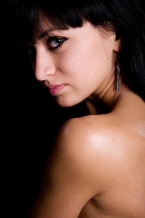 beauty brunette isolated on black background photo