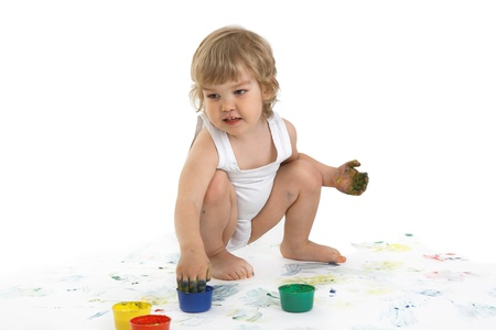 happy boy playing with paint  Stock Photo - 17953956