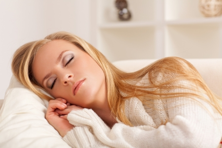 beauty girl sleeping on the sofa Stock Photo - 18241513