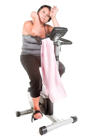 fat woman workout on the bicycle photo