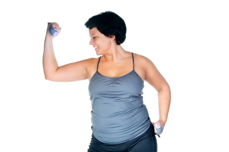 aerobic exercise: fat woman workout with dumbbells