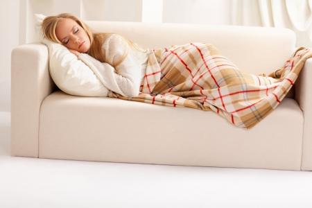 beauty girl sleeping on the sofa photo