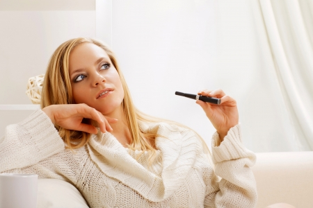 young beauty girl with e-cigarette photo