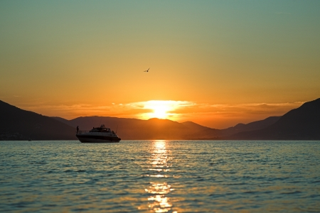 Sunset on adriatic sea with boat photo