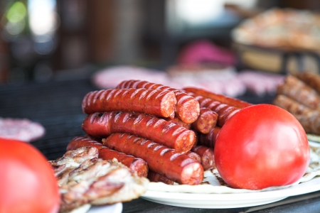 Detail of grilled sausage with tomato photo
