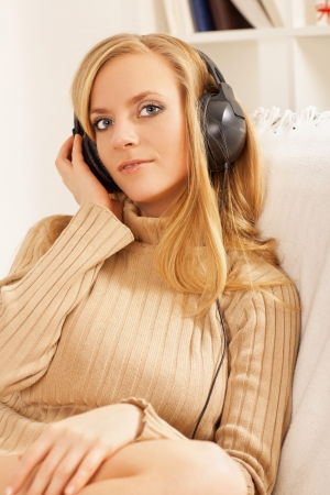 girl with headphone listening music photo